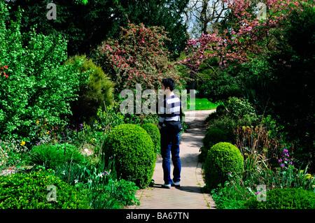 Paris France, Young Man, Promenading Alone, in Urban Park, Garden Pathway Springtime, 'Bois de Boulogne' - Stock Photo