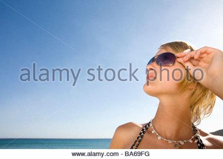 Stylish teenage girl posing on beach - Stock Photo