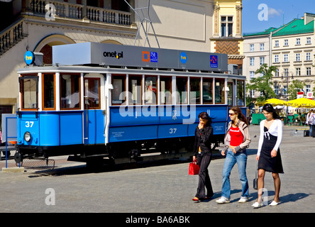 An antique tram near Cloth Hall on the Main Market in Cracow Poland - Stock Photo