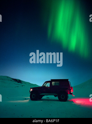 Jeep with Aurora Borealis or Northern Lights, Iceland - Stock Photo