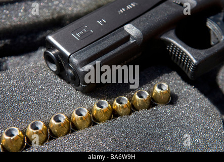 12 April 2009 Frederick Maryland A Glock 9mm handgun and its ammunition - Stock Photo