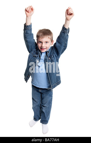 Young boy cheering with arms raised - isolated on white background - Stock Photo