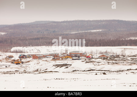 low grade coal being extracted from an open cast coal mine near Heihe on the Chinese Russian border. - Stock Photo