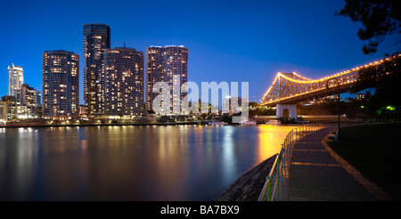 Brisbane city apartments at night and Story Bridge - Stock Photo