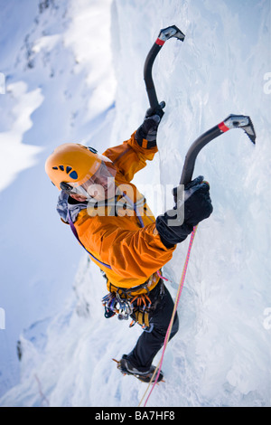 A man ice climbing on on a frozen waterfall, Corn Diavolezza near Pontresina, Grisons, Switzerland - Stock Photo