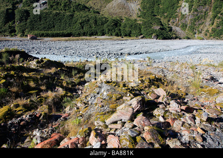 Boulders and rocks in glacial valley Fox river bed, West Coast, New Zealand - Stock Photo