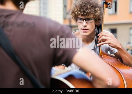 Stockholm, Sweden. Street musicians playing jazz and classical music in Stortoget square, Gamla Stan - Stock Photo