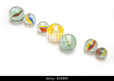 Glass marbles isolated on a white studio background - Stock Photo