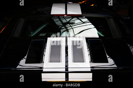 Rear view of the boot, engine vents and racing stripes on a Ford GT supercar - Stock Photo