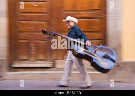 Double Bass player in street Guanajuato Mexico - Stock Photo
