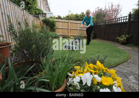 Hand lawn mower in small urban city domestic garden UK Stock Photo ...