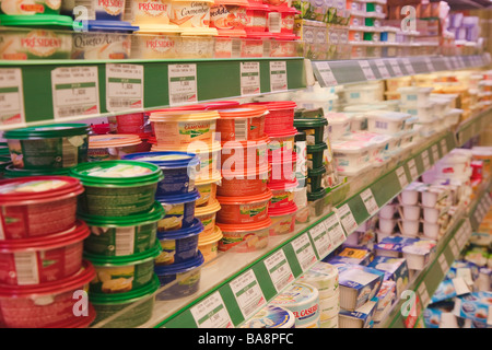 Dairy products in a SuperCor supermarket outlet of El Corte Ingles Spain - Stock Photo