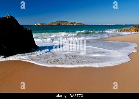 Beach Ilha de Pessegueiro with view to Island of Pessegueiro near Porto Covo - Stock Photo
