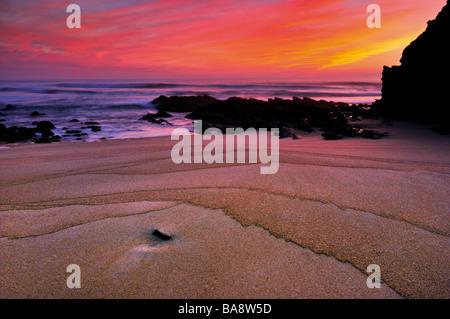 Portugal, Alentejo: Sundown and sand formations at beach Praia da Cerca Nova in Porto Covo - Stock Photo