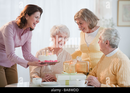 Senior woman celebrating birthday - Stock Photo
