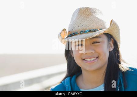 Portrait of teenage girl wearing cowboy hat - Stock Photo