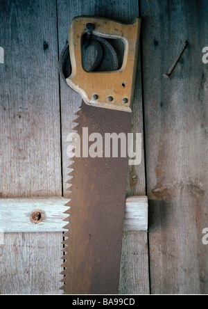 An old saw, close-up. - Stock Photo