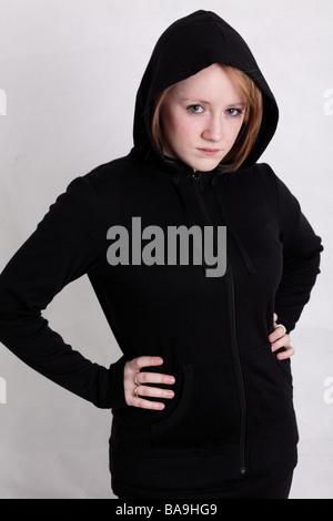 Blonde teenage girl in a black hoodie - youth social issues series - Stock Photo