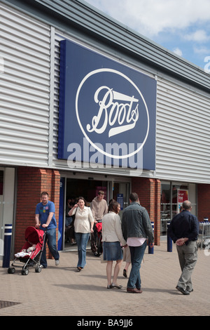 Shoppers at Boots the Chemist pharmacy store, Festival Retail Park, Stoke-on-Trent - Stock Photo