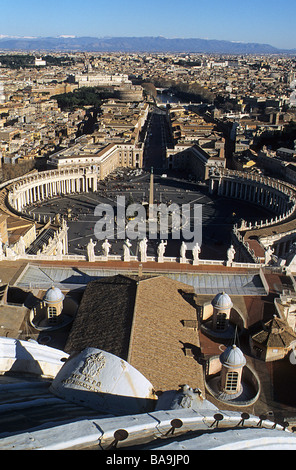Rome, view westwards from the top of the dome of St Peters Basilica, with dome in foreground - Stock Photo