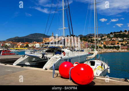 Red buoys at tthe landing stage for Catamarans moored in the Old Port of Menton, Côte d Azur, France - Stock Photo