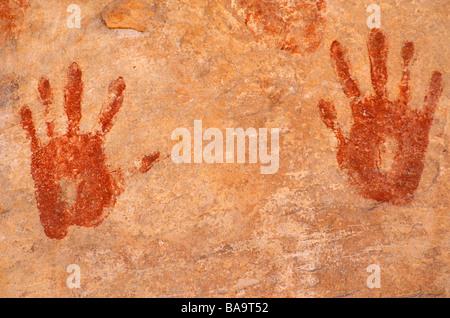 Anasazi hand prints at Turkey Pen Ruin Grand Gulch Primitive Area Cedar Mesa Utah - Stock Photo