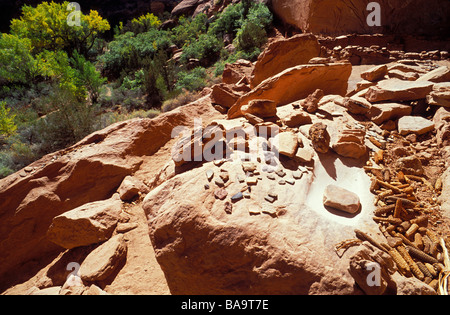 Pottery sherds corn cobs and grinding impressions at Junction Ruin Grand Gulch Primitive Area Cedar Mesa Utah - Stock Photo