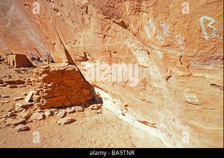 Anasazi hand prints and granaries at Turkey Pen Ruin Grand Gulch Primitive Area Utah - Stock Photo