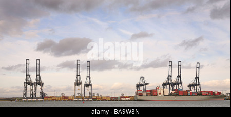 Boats and cranes at Felixstowe Docks and Dockyard - Stock Photo