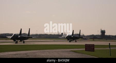 RAF Lakenheath two F 15 Strike Eagle E taxi s for take off at RAF Lakenheath in Suffolk - Stock Photo
