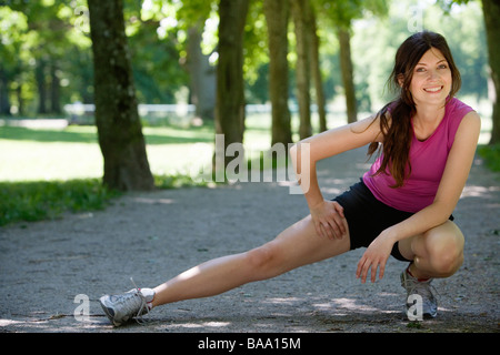 A woman doing stretching exercises, Stockholm, Sweden. - Stock Photo