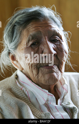 A First Nations female elder in her home in the community of Old Crow, Yukon Territory, Canada. - Stock Photo