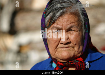 A First Nations female elder wears a head scarf in the community of Old Crow, Yukon Territory, Canada. - Stock Photo