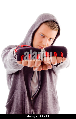 young male showing fists - Stock Photo