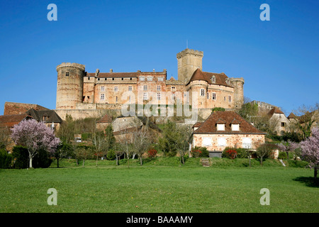 Castle and old village of Bretenoux in green fields France - Stock Photo