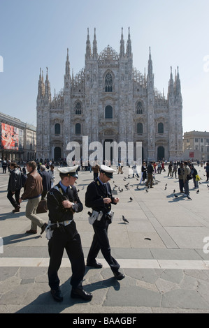 Two Italian policemen in the Duomo Cathedral square in Milan. Italy. - Stock Photo