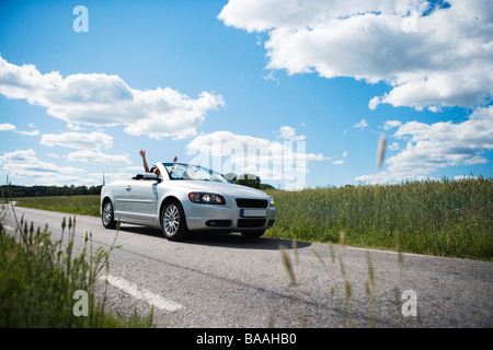 Two people in a car, Sweden. - Stock Photo