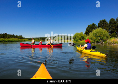 People kayaking and canoeing on a river. - Stock Photo