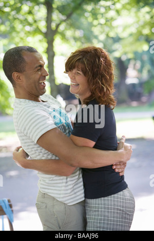 A smiling couple embracing, Stockholm, Sweden. - Stock Photo