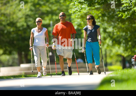 Three people nordic walking in Salt Lake City, Utah. - Stock Photo