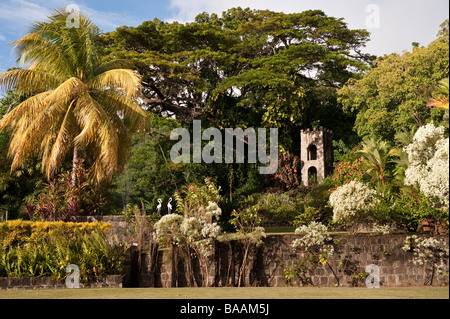 Estate bell in the beautiful garden at Romney Manor on the Caribbean island of St Kitts - Stock Photo