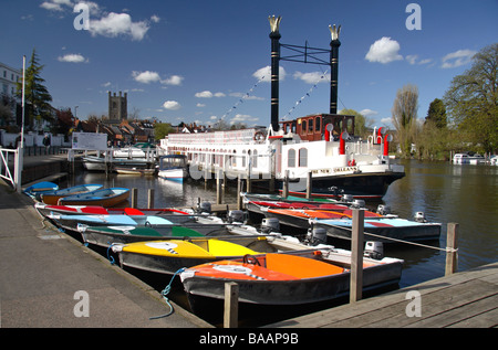 Colourful tourist motor boats for hire on the River Thames at Henley on Thames, Oxfordshire, UK. - Stock Photo