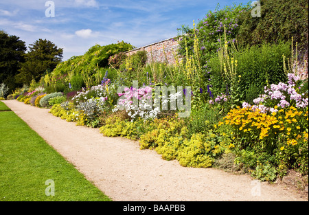 Colourful herbaceous perennial summer border on a sunny day at Waterperry Gardens Wheatley Oxfordshire England UK - Stock Photo
