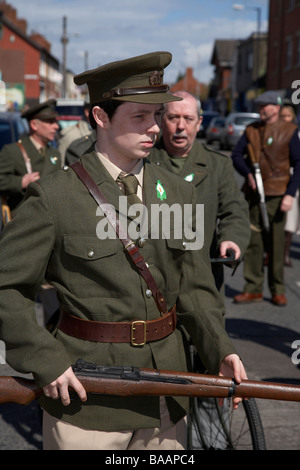 reinactors dressed in period costume representing an Irish Volunteers unit of the easter rising on Easter Sunday - Stock Photo