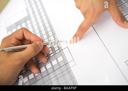 The hands of persons over a drawing in an office, Sweden. - Stock Photo