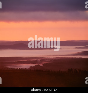 Lake amid mountains at dusk - Stock Photo