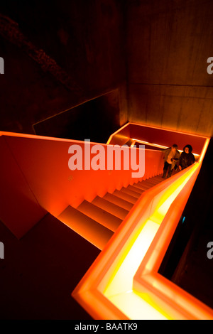 illuminated staircase at UNESCO world heritage site Zeche Zollverein industrial complex in Essen - Stock Photo