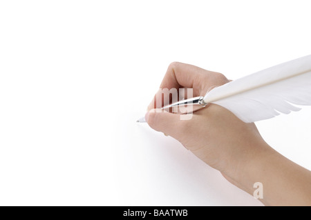Woman writing with a quill pen - Stock Photo