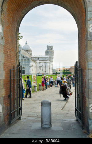 photograph of arched entrance to leaning tower of Pisa and piazza del duomo - Stock Photo