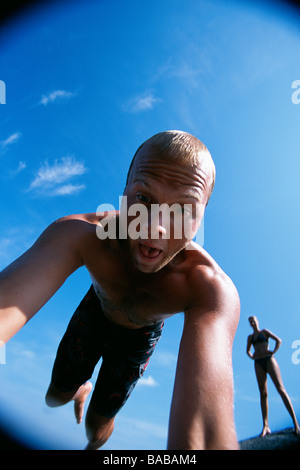 A man diving into the sea Sweden. - Stock Photo